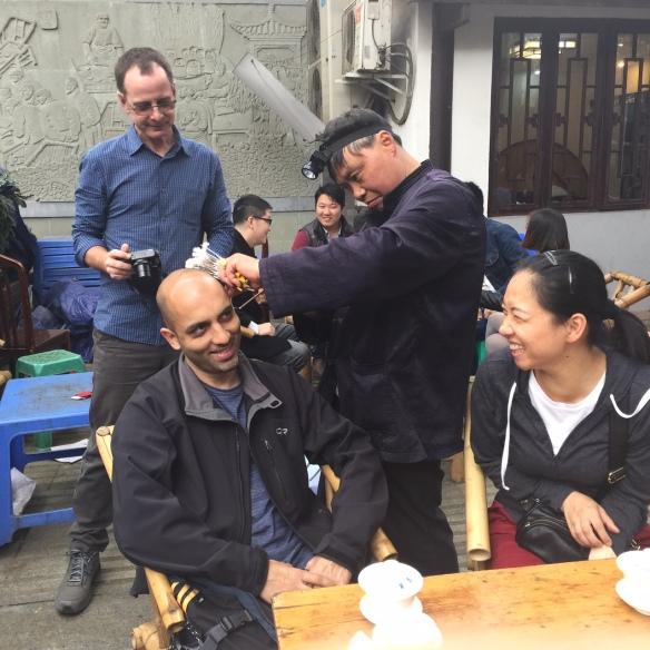 20150403 Ear clean Sameer Phillip Leslie  in peoples park in Chengdu China